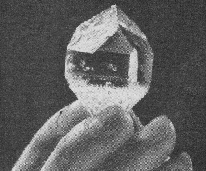 A quartz crystal.  That's a hand holding it.