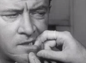 Still from the strange video. showing the narrator having his mouth probed.