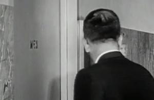 Hank Cameron entering a men's bathroom. Why? (Photo by Brian Schropp)