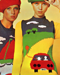 Sweaters with vehicles on them.